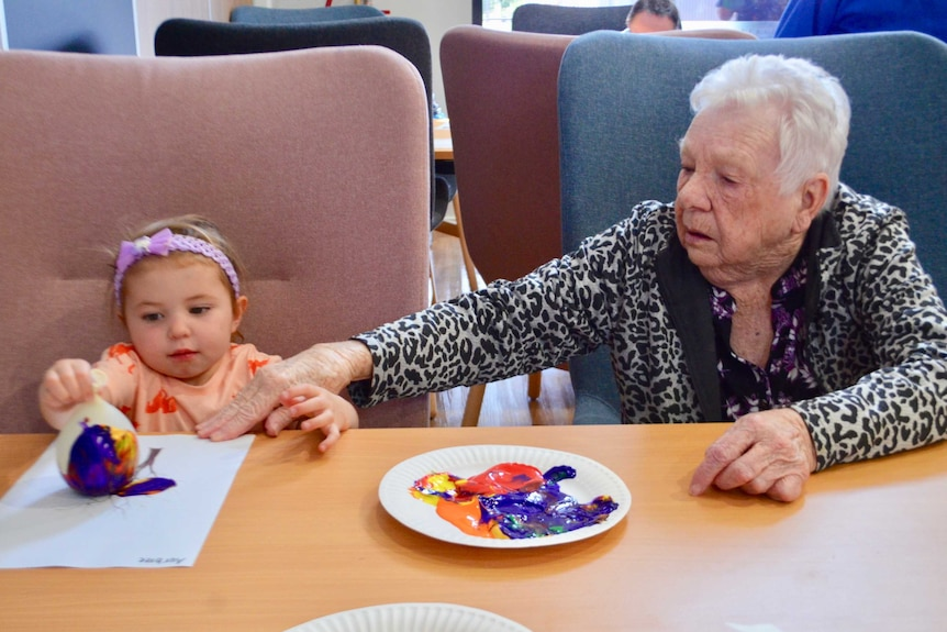 An elderly woman and a child