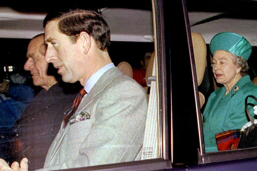 Prince Philip, Prince Charles, the Queen and her mother in a car.