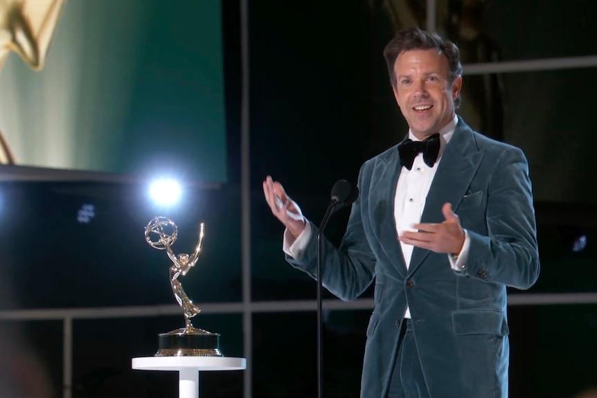 Jason Sudeikis accepts an Emmy Award.