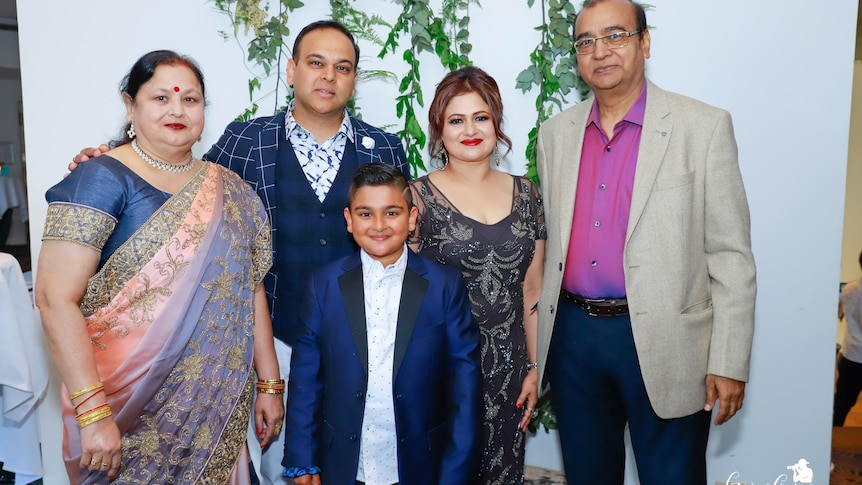 Gaurav Saxena (second from left) with his late mother (left) and father (right), and his wife and son.