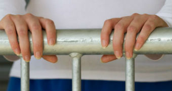 A woman's hand hold onto a metal railing