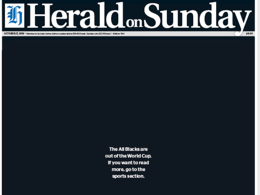 "A NZ Herald front page reads ""The All Blacks are out of the World Cup. If you want to read more, go to the sports section."""