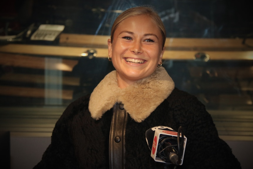 Grace Tame smiles during a radio interview with ABC Radio Hobart.