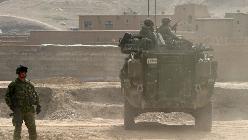 Canadian soldiers from the International Security Assistance Force (ISAF) keep guard