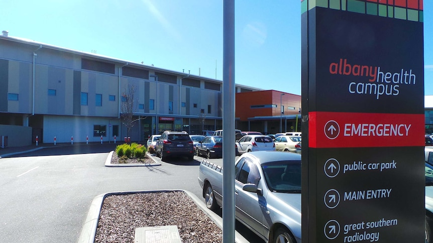 A sign showing way to Emergency, car park and radiology at Albany Health Campus.