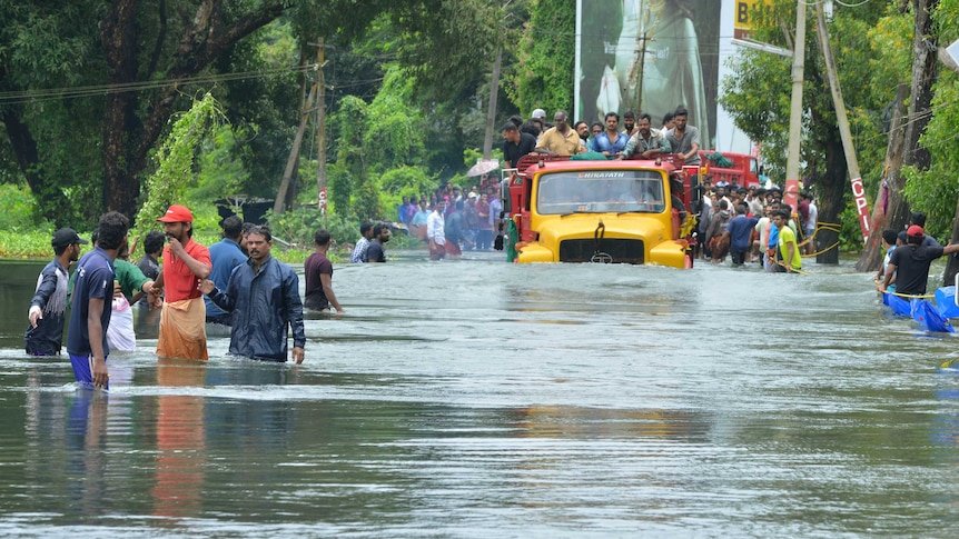 Indian military rescue mother and baby by helicopter from flood waters (Photo: AP)