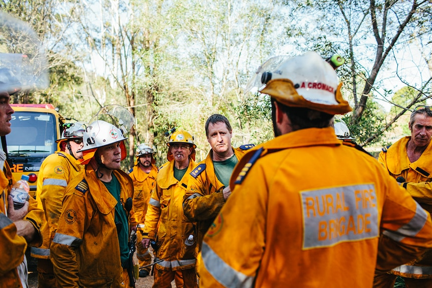 Rural fire fighters plan their next move away from the fire scene.