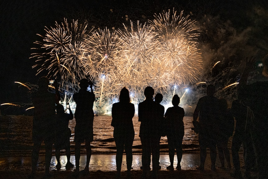 People watch on at the Territory Day fireworks celebrations at Mindil Beach in 2021.