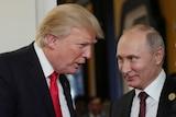 US President Donald Trump talking to a smiling Russian President Vladimir Putin.