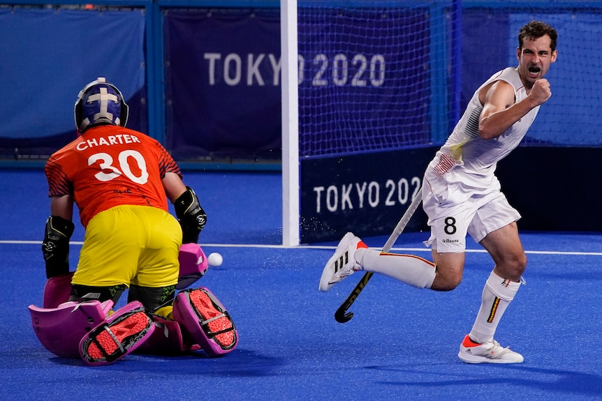 A Belgium men's hockey player pumps his first after scoring against Australia in a shootout.