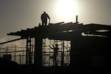 Residential construction workers at sunset