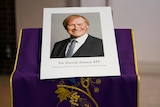 A picture of David Amess sits on an altar