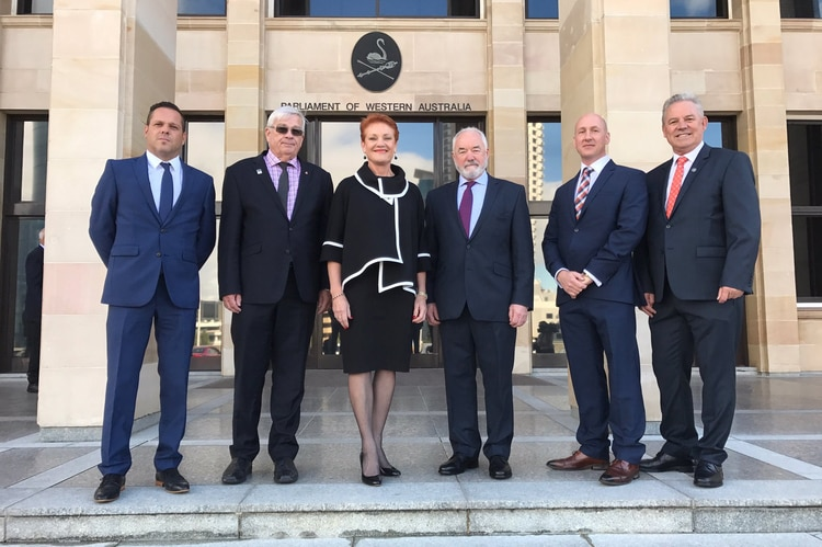 Six current and former One Nation members stand in front of WA Parliament House.