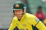 Michael Clarke runs between the wickets in World Cup warm up match against UAE