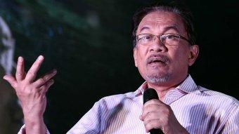 Malaysian opposition leader Anwar Ibrahim gestures as he gives a speech.