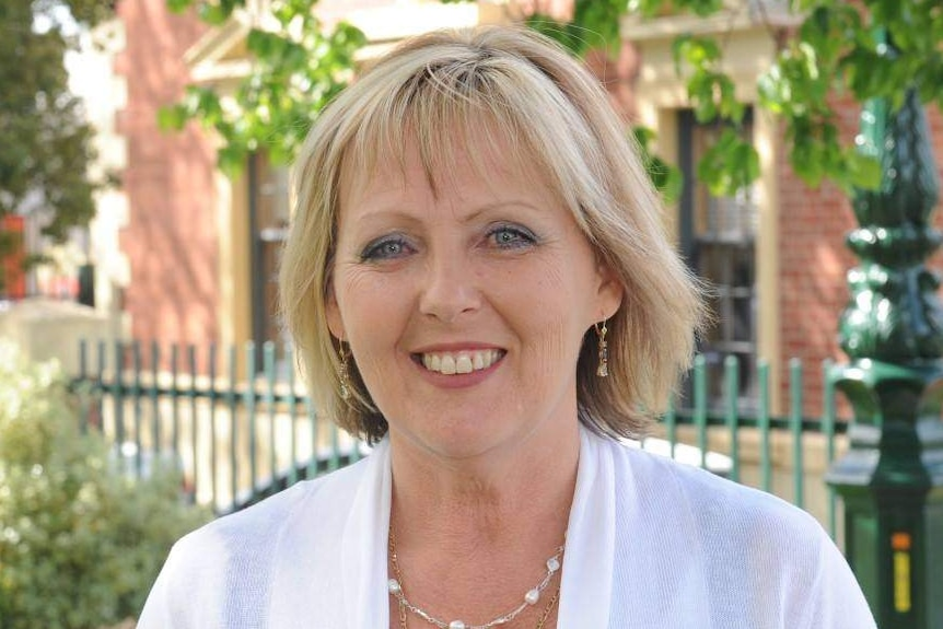 Former councillor Julie Hoskin photographed outside council buildings in Bendigo. She's smiling, wears a white blouse.
