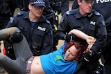 An Occupy Melbourne protester is removed at City Square in Melbourne