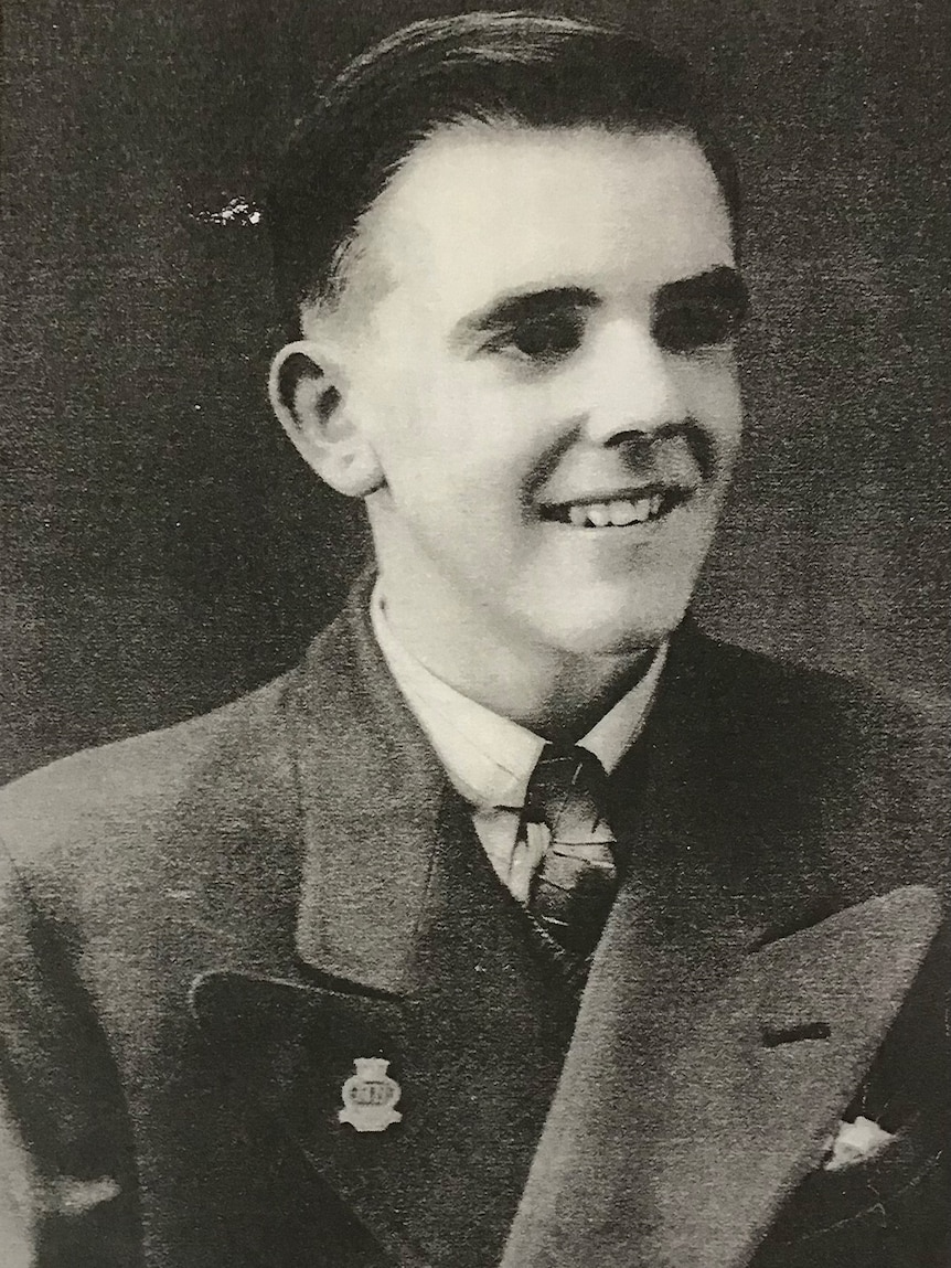 A young man in 1940s suit