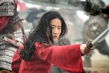 A film photo of a warrior woman in red.