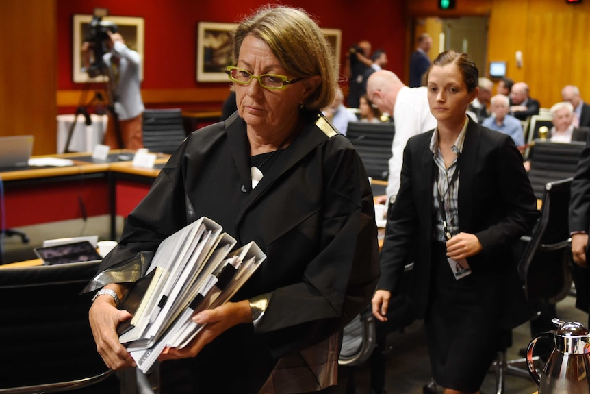 Megan Latham walking out of a hearing at the NSW Parliament.