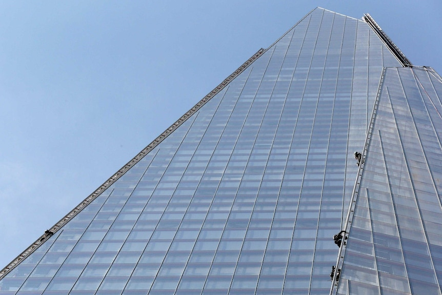 Six female protesters from Greenpeace scale The Shard in London.