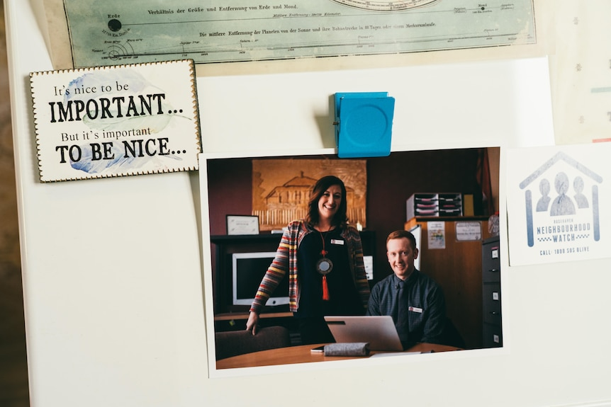 A man and a woman in a photo in a office space.