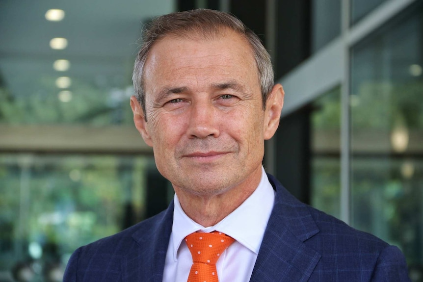 Health minister Roger Cook smiles at the camera.