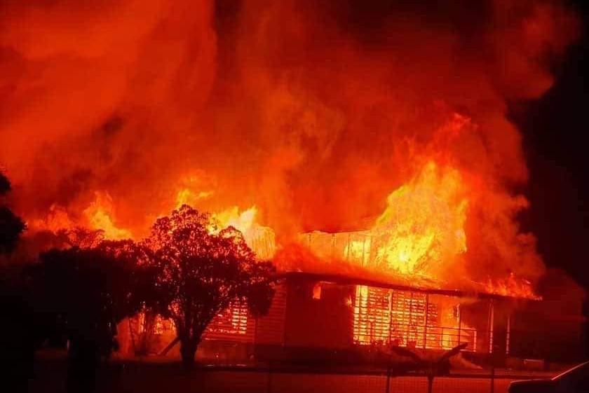 Huge orange and red flames engulf a catholic church in Bundaberg.