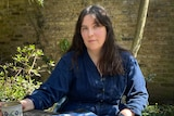 Author Evie Wyld siting outside