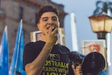 A young man with a megaphone