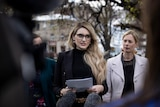 Alysha a sexual harassment complainant speaking at Hobart parliament lawns