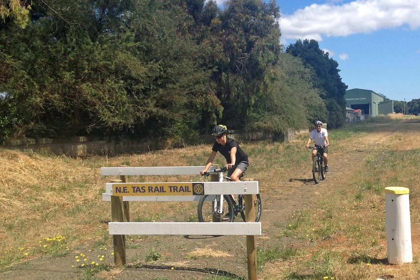 Cyclists approach the North-East rail trail in Tasmania