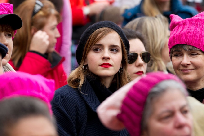 Actress Emma Watson surrounded by other women pictured in a story about self-partnering.