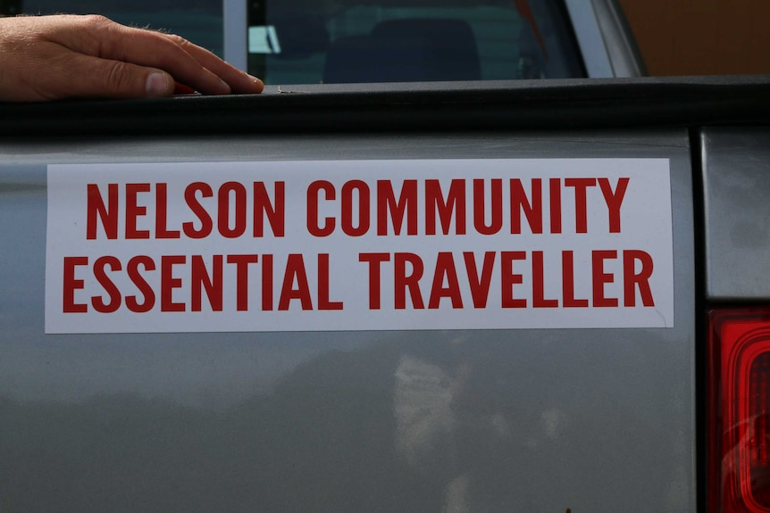 A picture of a bumper sticker that reads: Nelson Community Essential Traveller