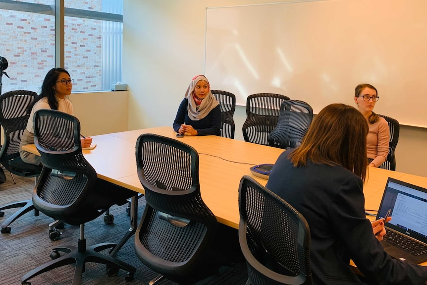 A group of women in a meeting room.