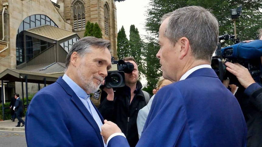 Bill Shorten confronted by Anglican priest over same-sex marriage comments