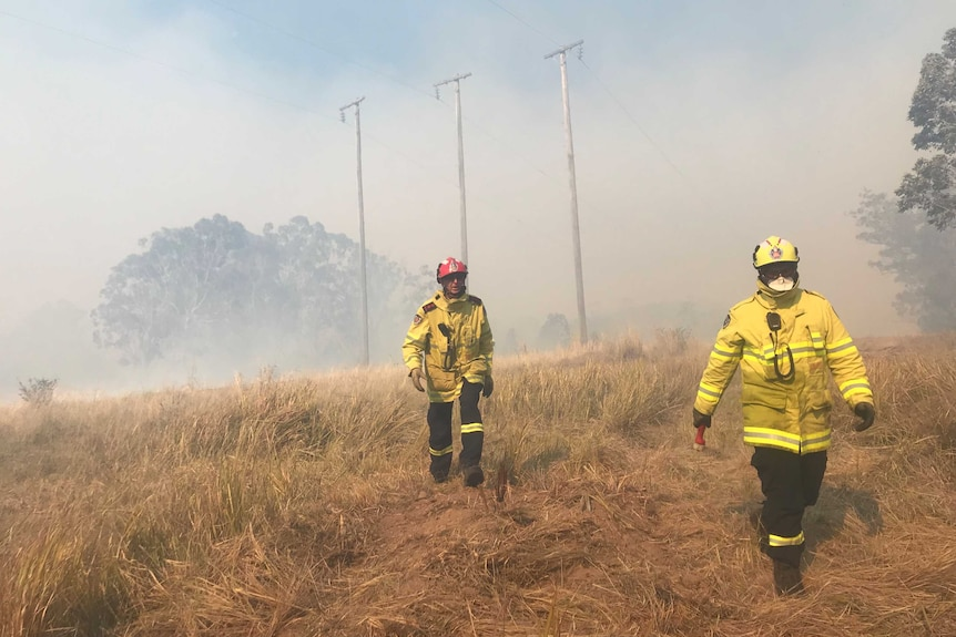 Firefighters protect isolated properties during a bushfire west of Kempsey.