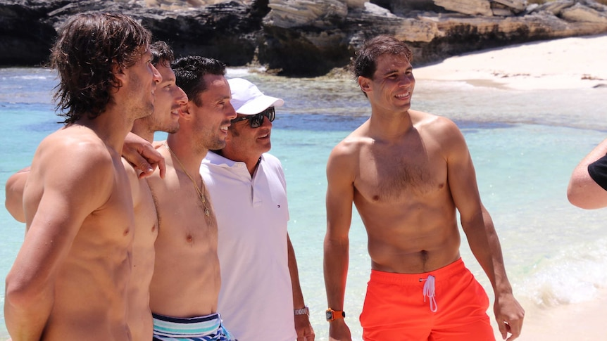 Rafael Nadal and some other tennis players in bathers on a beach on Rottnest Island off WA.