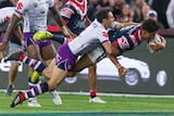 Latrell Mitchell carries Billy Slater over the line to score a try for the Roosters in the NRL grand final.
