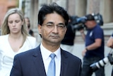 A tight mid shot of Lloyd Rayney walking outside court.