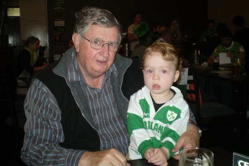 Bill Fogarty sitting down with his grandson Patrick on his lap