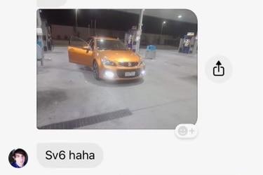 A screenshot of a Facebook message showing an image of an orange car.