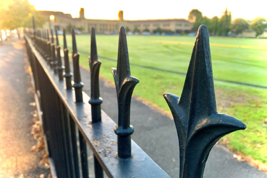 A photo of a fence outside Wesley College.