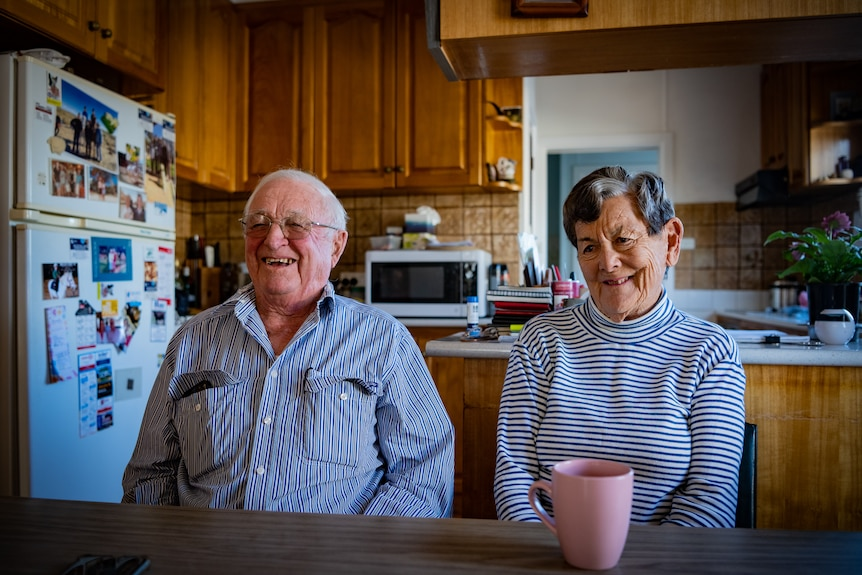 An older couple in the kitchen of a home