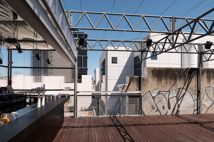 The rooftop of the Rechabite has left the graffiti and charred sections in place.