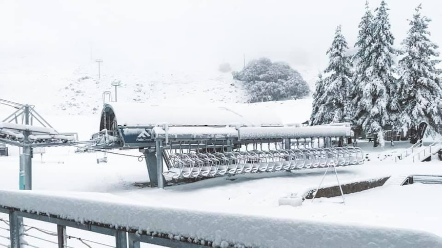 snow covered chairlift