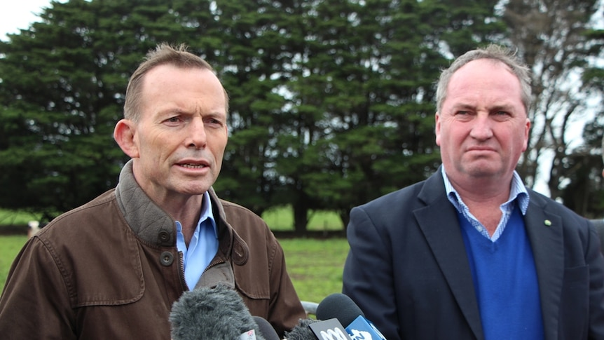 Prime Minister Tony Abbott and Agriculture Minister Barnaby Joyce on a dairy farm
