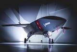 Boeing Loyal Wingman plane in hangar.