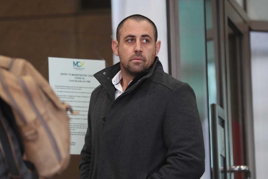 Sergeant Jonathon Edward Miller arrives at the Melbourne Magistrates Court in Melbourne.