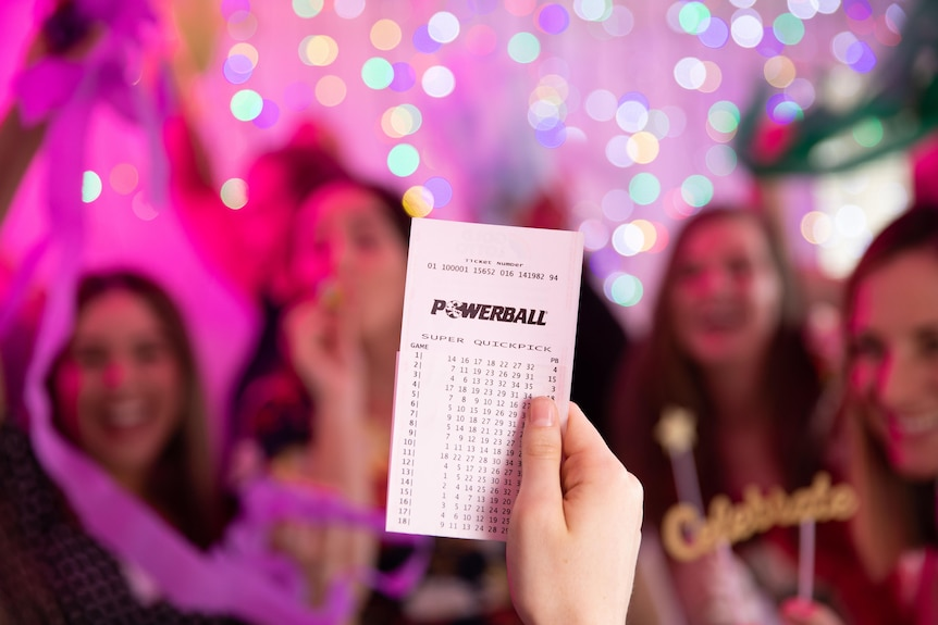 powerball ticket in front of blurred image of people